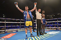 Martin J Ward (yellow/blue shorts) defeats Mohammed Kambuluta during a Boxing Show at the Copper Box Arena on 27th October 2018