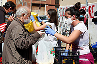 Rome April 25th 2020. Coronavirus lockdown. All over Italy the Coronavirus lockdown has improved the economic crisis, so in many neighborhoods associations and volunteers distribute food to less wealthy people. In Quarticciolo district on 25th of April (Anniversary of Italy's Liberation from nazi-fascism and Anniversary of the Resistance), volunteers of Red Lab distribute together with food, a red carnation and a photo.<br /> Photo Samantha Zucchi Insidefoto