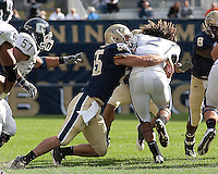 Pittsburgh linebacker Max Gruder brings down UConn tail back Andre Dixon. Pittsburgh Panthers defeat the University of Connecticut Huskies 24-21 on October 10, 2009 at Heinz Field, Pittsburgh, PA.