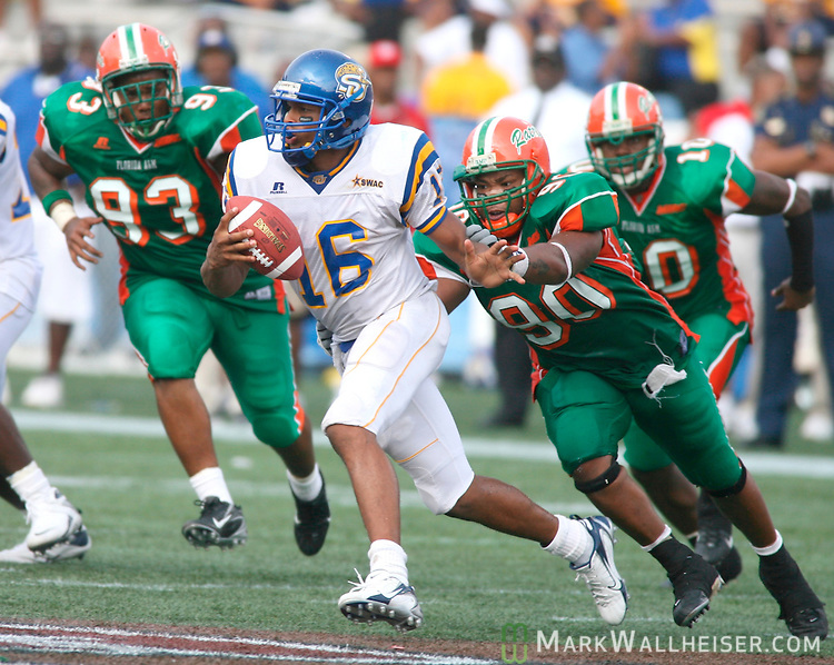 FAMU defenders Carlos Rolle (90) and Lymon Reed (93) pursue Southern quarterback Bryant Lee for the sack in the third quarter of the Rattler's game against the Southern University Jaguars at Legion Field in Birmingham, Alabama September 1, 2007.  FAMU lost to Southern 33-27.  (Mark Wallheiser/TallahasseeStock.com)