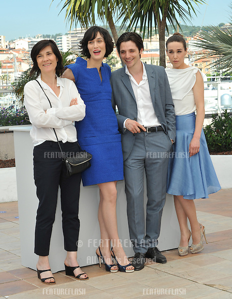 "Director Cathering Corsini (left) with actors Clotilde Hesme, Raphael Personnaz & Arta Dobroshi at the photocall for their new movie ""Three Worlds"" in competition at the 65th Festival de Cannes..May 25, 2012  Cannes, France.Picture: Paul Smith / Featureflash"