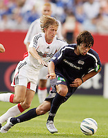D.C. United's Brian Carroll chases New England Revolution's Clint Dempsey. The New England Revolution and D.C. United finished in a scoreless tie in MLS play at Gillette Stadium, Foxboro, MA on Saturday August 28, 2004.