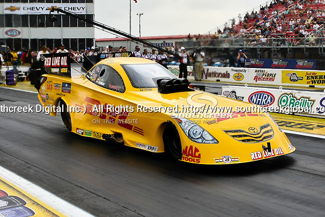 Jeff Arend (170) driver for the DHL Toyota Solara team makes a run at the O'Reilly Auto Parts Spring Nationals Finals at the Royal Purple Raceway in Baytown,Texas.