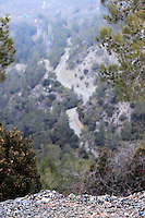 Stock photo: Blurred view of a road passing through the hills of the Troodos mountain in Cyprus, as seen from the very edge of a cliff.