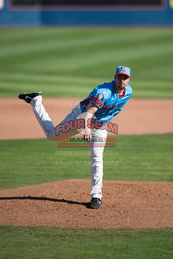 Spokane Indians starting pitcher Chi Chi Gonzalez (22) follows through on his delivery in a rehab assignment during a Northwest League game against the Vancouver Canadians at Avista Stadium on September 2, 2018 in Spokane, Washington. The Spokane Indians defeated the Vancouver Canadians by a score of 3-1. (Zachary Lucy/Four Seam Images)