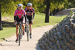 Cyclists Lee Neathery and Kevin Vincent ride at Eleanor Tinsley Park Friday Nov. 17,2006.(Dave Rossman/For the Chronicle)<br />