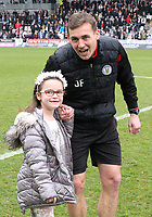 St Mirren Assistant Manager James Fowler with his daughter, celebrates after winning the Scottish Professional Football League Ladbrokes Championship at the Paisley 2021 Stadium, Paisley on 14.4.18.