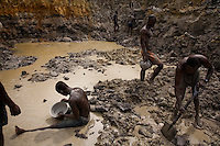 Gold mining on river banks outside of Prestea. The little girl in the photographs is said to have fallen out of bed during a blast and cut the back of her head.  The brain injury keeps her from walking well and she does not speak.