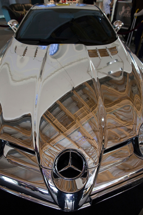 Moscow, Russia, 25/10/2009..A chrome Mercedes sports car sports car at the Millionaire Fair in Moscow. The event has become an annual fixture, attracting thousands of would-be and existing Russian millionaires to view and purchase a wide range of luxury goods. This year however the fair was much smaller, an indication of how the formerly booming Russian economy has been hit by the world financial crisis.