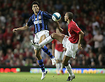 Manchester United's Rio Ferdinand tackles Inter Milan's Julio Cruz. Pic SPORTIMAGE/Dave Thompson..Pre-Season Friendly..Manchester United v Internazionale..1st August, 2007..--------------------..Sportimage +44 7980659747..admin@sportimage.co.uk..http://www.sportimage.co.uk/