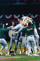 SAN FRANCISCO, CA - Dennis Eckersley and the Oakland Athletics celebrate winning the 1989 Earthquake World Series after beating the San Francisco Giants in Game 4 of the 1989 Series at Candlestick Park in San Francisco, California in 1989. Photo by Brad Mangin