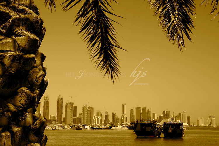 Traditional Dhow, Arabian fishing boats in front of Doha West Bay Cityscape, Corniche, Doha, Qatar | Sept 09