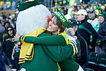 010213--The Oregon Duck hugs Ducks fan Laine Bleadon of Scottsdale who is a originally from Medford, Oregon, during a pep rally at Salt River Fields in a parachute in  Scottsdale, Arizona. .Photo by Jaime Valdez