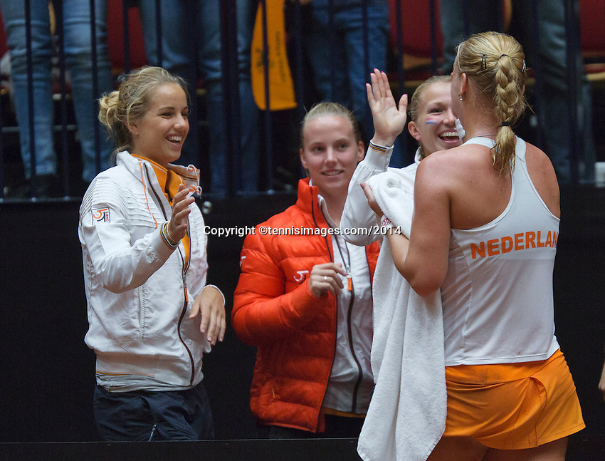 The Netherlands, Den Bosch, 16.04.2014. Fed Cup Netherlands-Japan, Kiki Bertens being congratulated by het team members Arantxa Rus, Rachel Hogenkamp and Michaella Krajicek, <br /> Photo:Tennisimages/Henk Koster