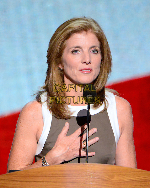 Caroline Kennedy.at the 2012 Democratic National Convention in Charlotte, North Carolina, USA, September 6th, 2012.  .half length speaking podium microphone white trim brown dress hand .CAP/ADM/CNP/RS.©Ron Sachs/CNP/ADM/Capital Pictures.