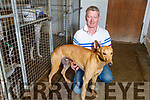 Brendan Maunsell with his greyhound Cash Is King in his kennels at his home in Abbeydorney on Saturday.