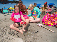 Chloe Pedrad, 9, (left) of Richboro, Pa. and Jolee Wiener,  10 of Holland, Pa. play in the sand during the 11th annual 21 Down Beach Day Monday, July 15, 2019 at Schellenger Street beach in Wildwood, New Jersey. Every summer, the Wildwood Beach Patrol opens Lincoln Ave Beach for kids with down syndrome and their families for 21 Down Beach Day. Often, kids with down syndrome aren't comfortable in the ocean. Their parents can't just relax and watch them frolic. But on July 15th, the kids swim with seasoned Wildwood lifeguards on soft-top paddle boards. (Photo by William Thomas Cain / CAIN IMAGES)