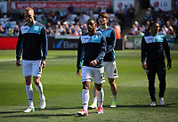 (L-R) Mike van der Hoorn, Luciano Narsingh, Ki Sung Yueng and Jefferson Monter of Swansea City exit the pitch after warming up prior to the Premier League match between Swansea City and Stoke City at The Liberty Stadium, Swansea, Wales, UK. Saturday 22 April 2017