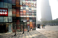 People walk into the newly opened The Village luxury shopping mall in the Sanlitun district of Beijing, China.