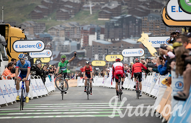 The King of Wheelies (and also the King of the Green Jersey) Peter Sagan (SVK/Bora-Hansgrohe) entertaining the finish line crowd with his trademark trick as he crosses the finish line<br /> <br /> shortened stage 20: Albertville to Val Thorens (59km in stead of the original 130km due to landslides/bad weather)<br /> 106th Tour de France 2019 (2.UWT)<br /> <br /> ©kramon