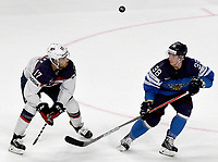 American Nick Schmaltz (L) and Finland's Juuso Hietanen losing sight of the puck during the Ice Hockey World Championship quarter-final match between the US and Final in the Lanxess Arena in Cologne, Germany, 18 May 2017. Photo: Monika Skolimowska/dpa /MediaPunch ***FOR USA ONLY***