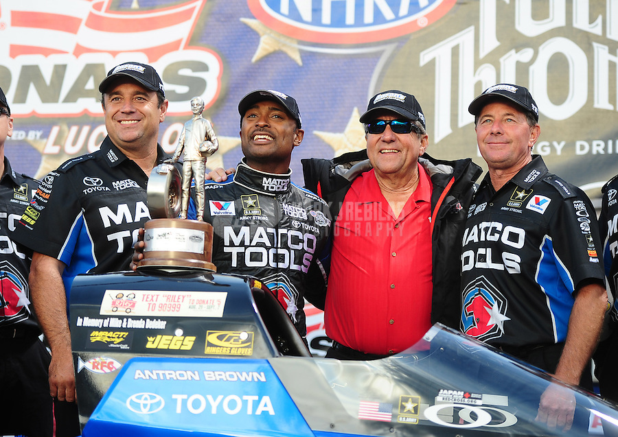 Sept. 5, 2011; Claremont, IN, USA: NHRA top fuel dragster driver Antron Brown celebrates with his crew after winning the US Nationals at Lucas Oil Raceway. Mandatory Credit: Mark J. Rebilas-