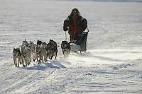 Saturday March 10, 2007   ----   Ray Redington Jr.'s dogs kick up just enough snow for the wind to whip it down the trail on the Yukon river shorlty before the Anvik checkpoint  on Saturday morning.