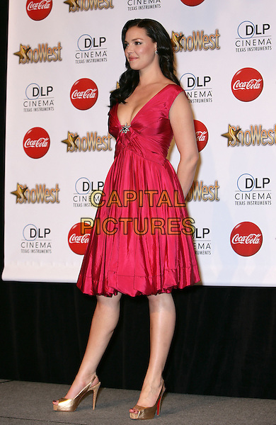 KATHERINE HEIGL.SHOWEST Final Night Talent Awards at the Paris Resort Hotel and Casino,  Las Vegas, Nevada , USA,.18th March 2010..full length red dress sleeveless gold platform christian louboutin shoes heels cork open peep toe slingbacks side profile low cut pink .CAP/ADM/MJT.© MJT/AdMedia/Capital Pictures.