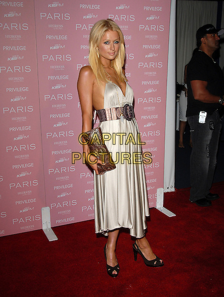 PARIS HILTON.At The Paris Hilton CD Release Party held at Privelege in West Hollywood, California, USA, August 18, 2006..full length silver grey dress black dress halterneck brown purple crocodile skin effect belt clutch bag .Ref: DVS.www.capitalpictures.com.sales@capitalpictures.com.©Debbie VanStory/Capital Pictures
