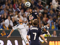 Phily defender Sheanon Williams (25) goes over LA Galaxy midfielder Landon Donovan (10). The LA Galaxy defeated the Philadelphia Union 1-0 at Home Depot Center stadium in Carson, California on  April  2, 2011....