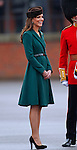 """CATHERINE, DUCHESS OF CAMBRIDGE PREGNANT .An official staement by Buckingham Palace confirmed Kate's pregnancy. However, no date of birth has been given...KATE'S PRESENTS SHAMROCKS TO IRISH GUARDS.The Duchess of Cambridge presented shamrocks to members of 1 Irish Guards at Mons Barracks in Aldershot to mark the occasion of St Patricks Day_17/03/2012.Mandatory Credit Photo: ©NEWSPIX INTERNATIONAL..**ALL FEES PAYABLE TO: """"NEWSPIX INTERNATIONAL""""**..IMMEDIATE CONFIRMATION OF USAGE REQUIRED:.Newspix International, 31 Chinnery Hill, Bishop's Stortford, ENGLAND CM23 3PS.Tel:+441279 324672  ; Fax: +441279656877.Mobile:  07775681153.e-mail: info@newspixinternational.co.uk"""