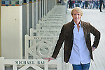 Michael Bay poses during the unveiling of his dedicated beach locker room on the Promenade des Planches during the 41st Deauville American Film Festival on September 11, 2015 in Deauville, France
