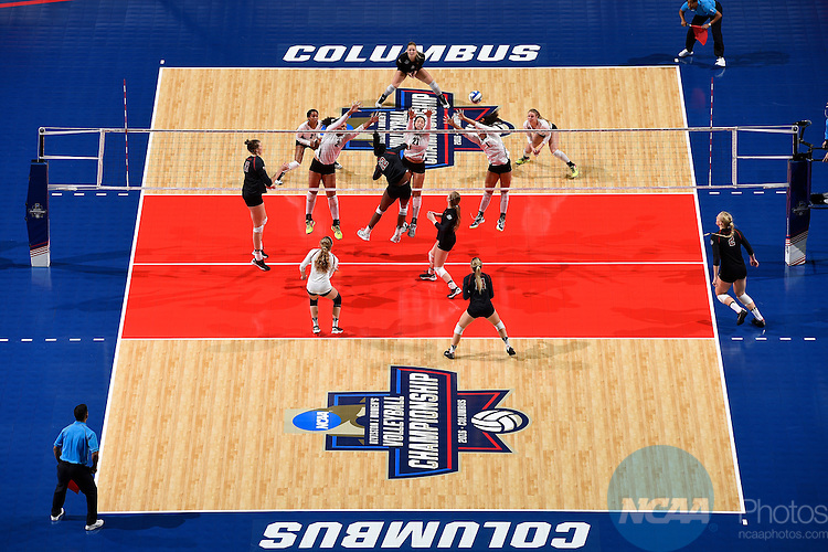 COLUMBUS, OH - DECEMBER 17:  Inky Ajanaku (12) of Stanford University hits a kills past Yaazie Bedart-Ghani (27) of the University of Texas during the Division I Women's Volleyball Championship held at Nationwide Arena on December 17, 2016 in Columbus, Ohio.  Stanford beat Texas 3-1 to win the national title. (Photo by Jamie Schwaberow/NCAA Photos via Getty Images)