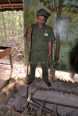 Asia, Vietnam, Cu Chi nr. Ho Chi Minh City (Saigon). Cu Chi Tunnels. Guide explaining booby traps used by the Vietnamese during the Vietnam War.