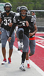 Lindenwood player Trey Parker, who formerly played for Belleville East HS, runs a high-stepping drill during a light rain.
