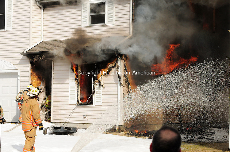 TORRINGTON, CT, 04 MAR 13- 030413AJ04- A house at 64 Griswold St. in Torrington burns Monday afternoon.  Alec Johnson/ Republican-American