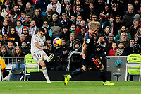 Real Madrid's Sergio Reguilon and Valencia CF's Daniel Wass during La Liga match between Real Madrid and Valencia CF at Santiago Bernabeu Stadium in Madrid, Spain. December 01, 2018. (ALTERPHOTOS/A. Perez Meca) /NortePhoto NORTEPHOTOMEXICO