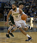 Nevada's Cody Martin drives  against Colorado State in the second half of an NCAA college basketball game in Reno, Nev., Sunday, Feb. 25, 2018. (AP Photo/Tom R. Smedes)