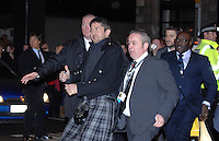 Scottish Actor Gerard Butler arrives at the Glasgow/UK premiere of his movie Law Abiding Citizen......Gerard is escorted back from visiting fans on the opposite side of the road!!..