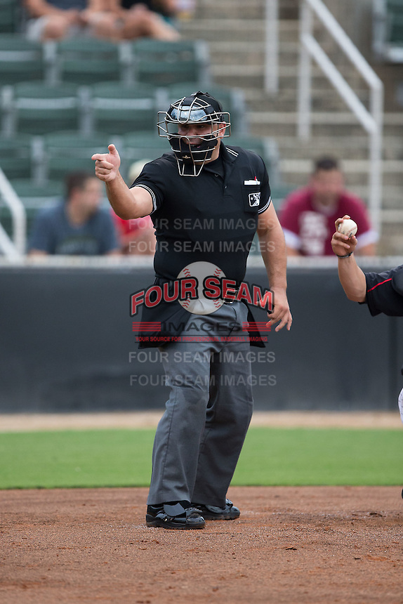 Home plate umpire Alex Trujillo makes a strike call during the South Atlantic League game between the Lakewood BlueClaws and the Kannapolis Intimidators at Intimidators Stadium on July 14, 2015 in Kannapolis, North Carolina.  The Intimidators defeated the BlueClaws 8-2.  (Brian Westerholt/Four Seam Images)