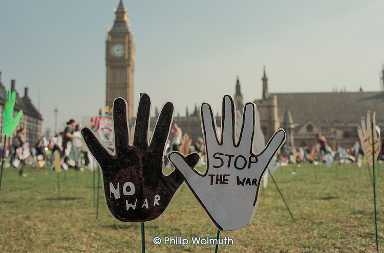 Part of a field of 2500 cardboard hands planted in Parliament Square by Hands Up For Peace, an anti-war campaign set up by school students to protest at the invasion of Iraq.