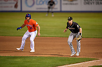 Charlotte Knights first baseman Zack Collins (8) in the field as Tim Tebow (15) leads off during an International League game against the Syracuse Mets on June 11, 2019 at NBT Bank Stadium in Syracuse, New York.  Syracuse defeated Charlotte 15-8.  (Mike Janes/Four Seam Images)