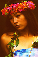 A local Hawaiian woman with a Hake lei made out of red and pink bougainvilleas