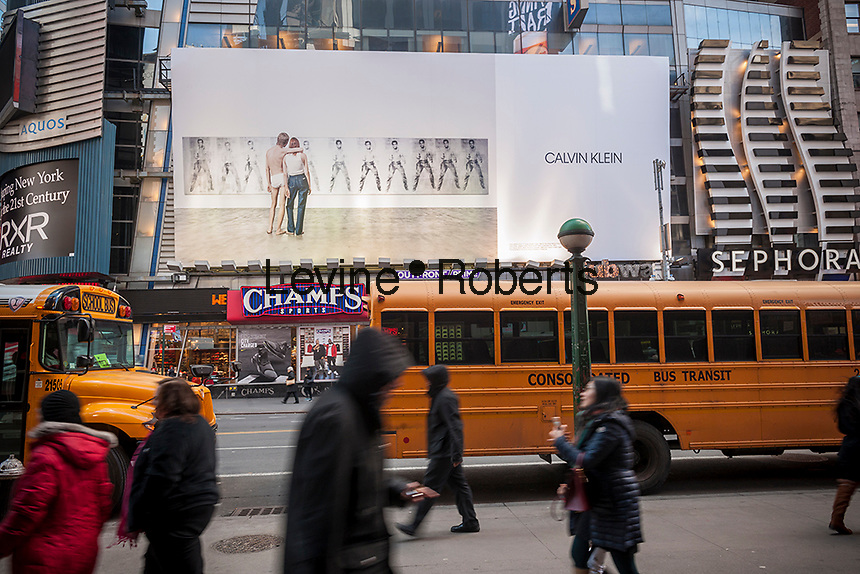 A rather demure billboard advertising the Calvin Klein brand with the firm's new logo in Times Square in New York on Thursday, February 16, 2017. Calvin Klein recently updated their logo with the name all in caps and decreased kerning between the letters. This particular iteration was designed by Peter Saville and Klein has changed and updated their mark several times since 1968. (© Richard B. Levine)