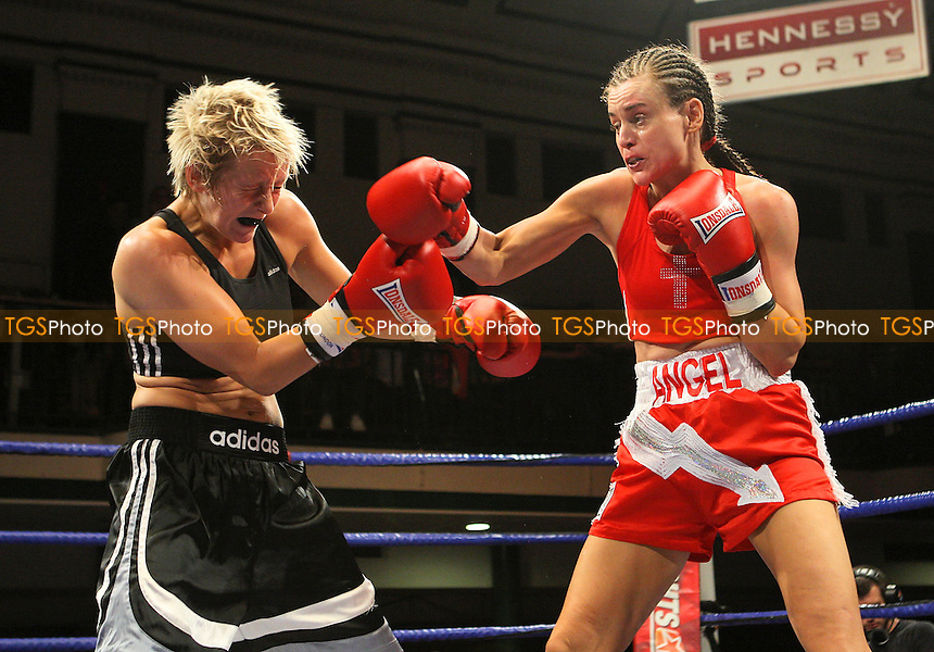 Angel McKenzie (Thornton Heath, red shorts) defeats Lana Cooper (Wales, black shorts) in a Featherweight Boxing contest at York Hall, Bethnal Green, promoted by Hennessy Sports - 18/07/09 - MANDATORY CREDIT: Gavin Ellis/TGSPHOTO - Self billing applies where appropriate - Tel: 0845 094 6026