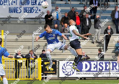 2014-04-20 / voetbal / seizoen 2013-2014 / ASV Geel - Boussu Dour / Een luchtduel tussen Ben Santermans (l) (Geel) en Alexandre Lauriente (r) (Boussu Dour)