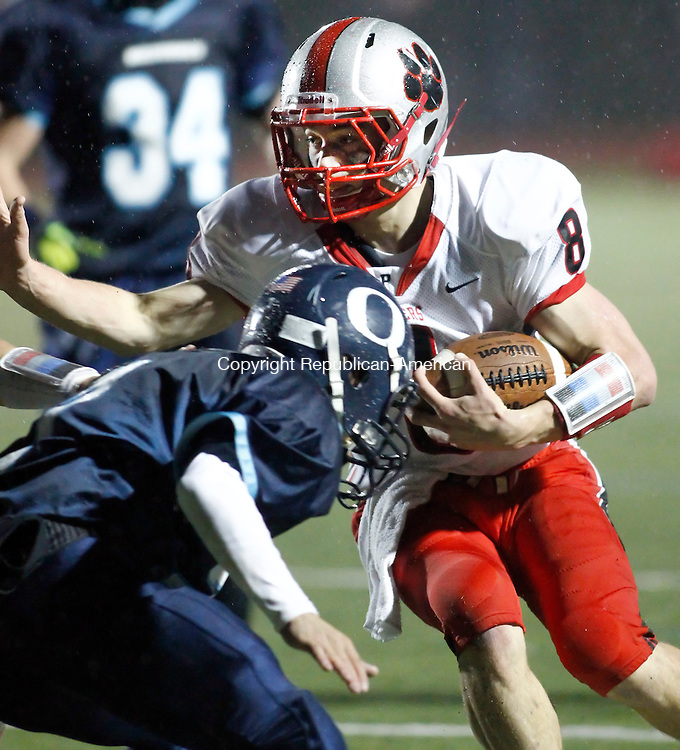 Southbury, CT-22 November 2011-110211CM06-  Pomperaug's Andrew Reel carries the ball as Oxford's Chrstopher VanKamerik moves in to make the tackleTuesday night in Southbury. Pomperaug won 10-7.   Christopher Massa Republican-American