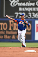 New York Mets shortstop Ruben Tejada (11) during a spring training game against the Washington Nationals on March 27, 2014 at Tradition Field in St. Lucie, Florida.  Washington defeated New York 4-0.  (Mike Janes/Four Seam Images)