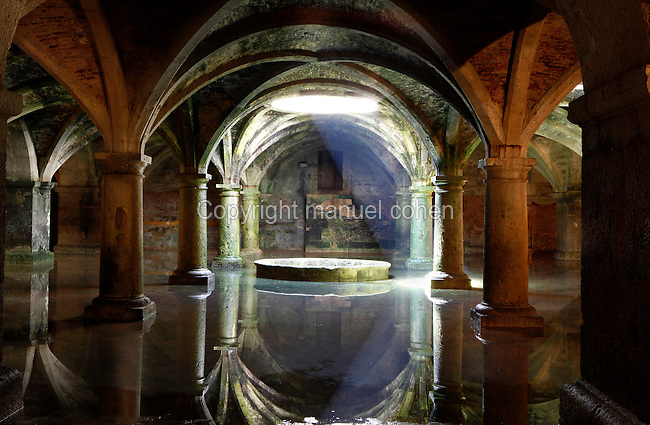 General view of Manueline Cistern of the El Jadida (Mazagan) fortress, built by Francisco and Diogo de Arruda, 16th century, El Jadida, Morocco. El Jadida, previously known as Mazagan (Portuguese: Mazag√£o), was seized in 1502 by the Portuguese, and they controlled this city until 1769. The underground Cistern was originally designed to store munitions. It served as a fencing school before being used after completion of the town walls in 1541 as a tank to store water. The symmetrical construction has a vaulted roof supported by 25 circular and rectangular pillars, with just one central window in the ceiling, 3.5 m in diameter, producing a single shaft of light. The shallow sheet of water produces a shimmering reflection of the vaulted ceiling in the light. Picture by Manuel Cohen