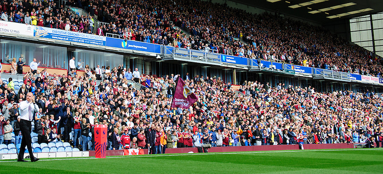 Burnley's Manager Sean Dyche acknowledges the fans as he walks out onto the pitch ahead of his sides first Premier League game of the season<br /> <br /> Photographer Chris Vaughan/CameraSport<br /> <br /> Football - The Premier League - Burnley v Swansea City - Saturday 13th August 2016 - Turf Moor - Burnley<br /> <br /> World Copyright &copy; 2016 CameraSport. All rights reserved. 43 Linden Ave. Countesthorpe. Leicester. England. LE8 5PG - Tel: +44 (0) 116 277 4147 - admin@camerasport.com - www.camerasport.com